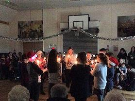 Year 6 holding the Christingles.