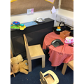 Role play area in nursery with technology