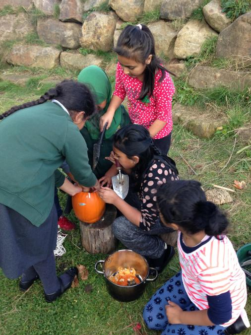 Carving pumpkin lanterns for Diwali