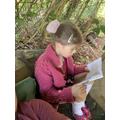 Katie enjoying reading in her outdoor den.