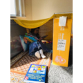 Amel reading in her den. A well constructed den!