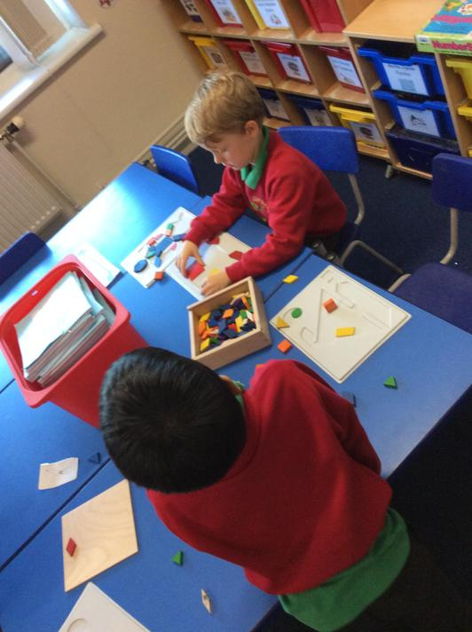 We began to think about tessellation and made shape pictures in frames.