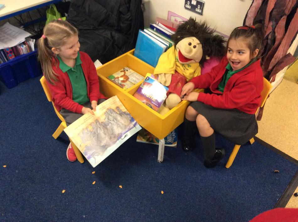 The puppet loves stories being read to her!