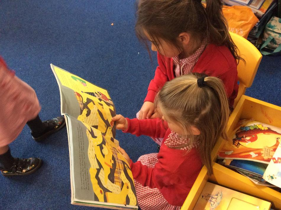 Enjoying our new princess and wizard story in the book corner!