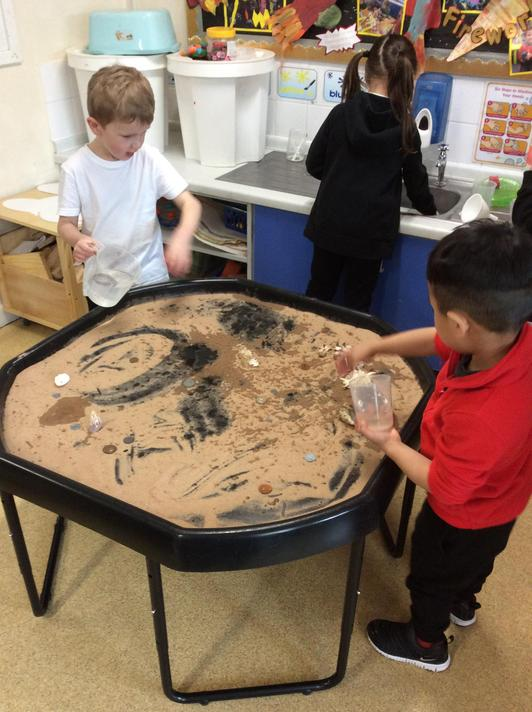 Exploring sand, water and shells. Did you know that one shell acted like a funnel?!