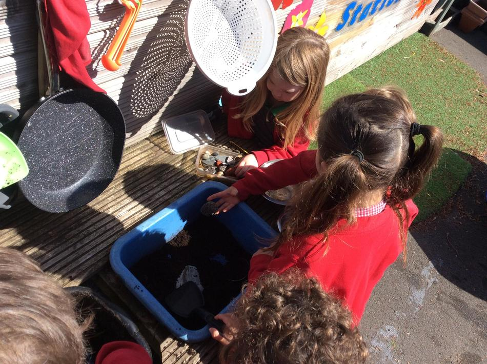 Making food in our mud kitchen for the tiger.