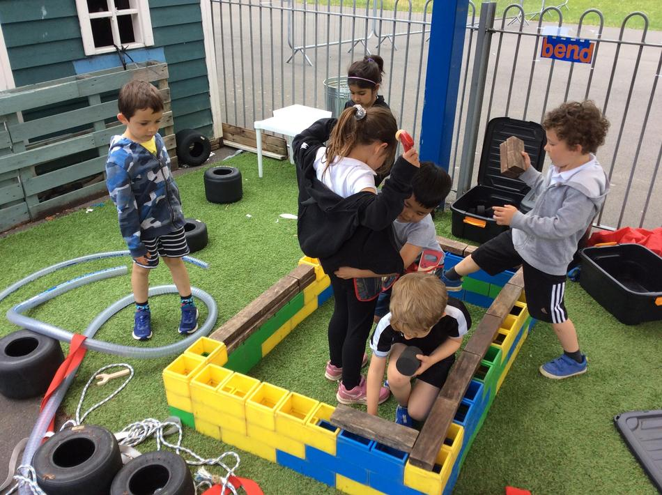 Making a castle in our outdoor construction area. We worked as a team beautifully!