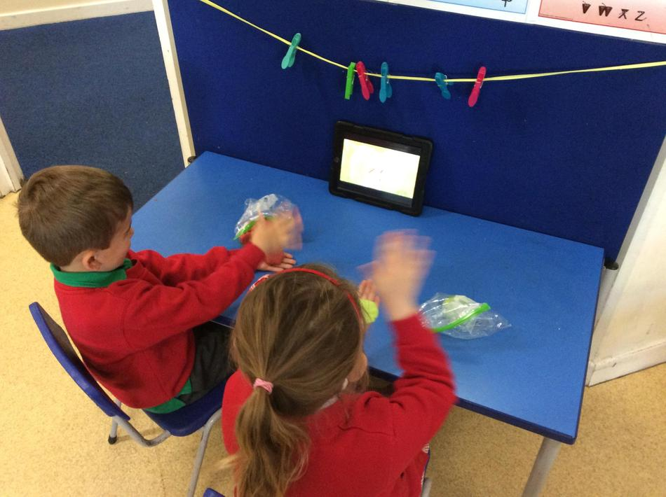 Doing our 'Down in the Jungle' dough disco to strengthen our fingers!