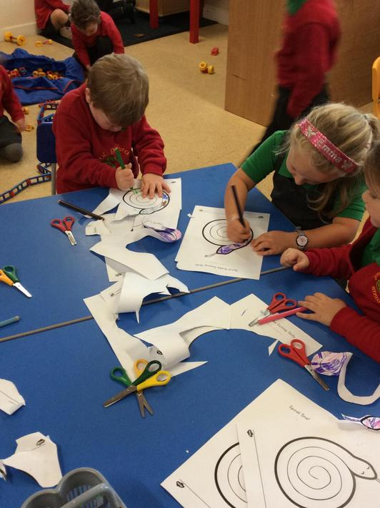 using playdough, scissors and construction toys to help us with our pencil control.