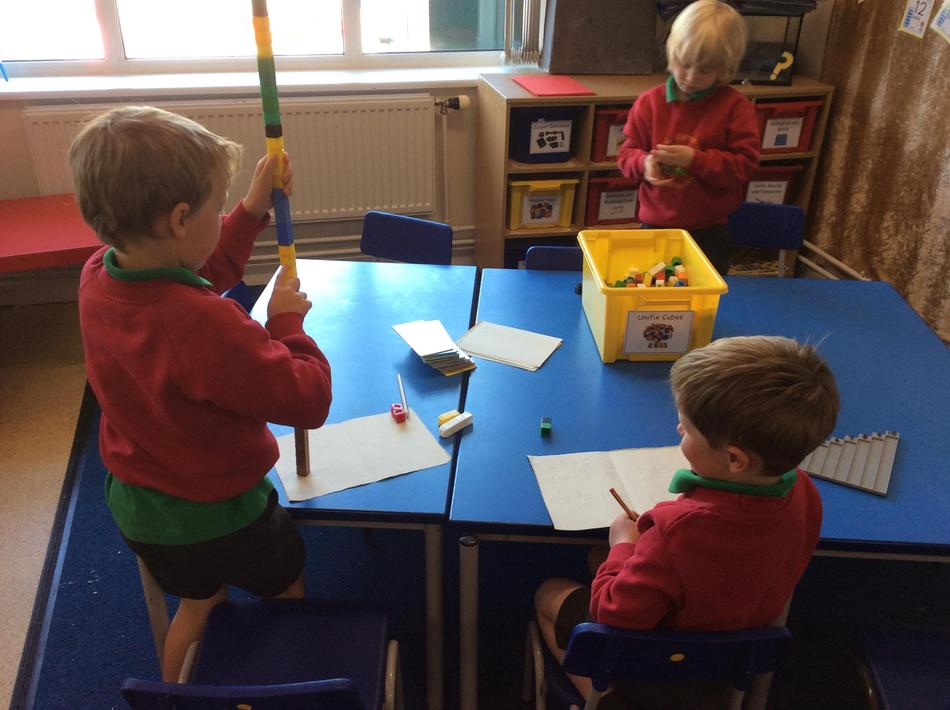 We made and wrote our own doubles and halves number sentences using unifix!