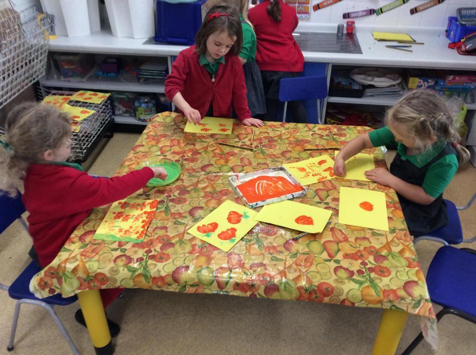 Making our own fist print pumpkins!