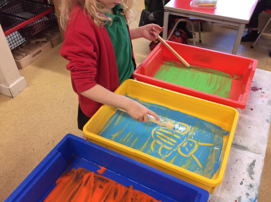 Creating Minibeasts using paint and brushes