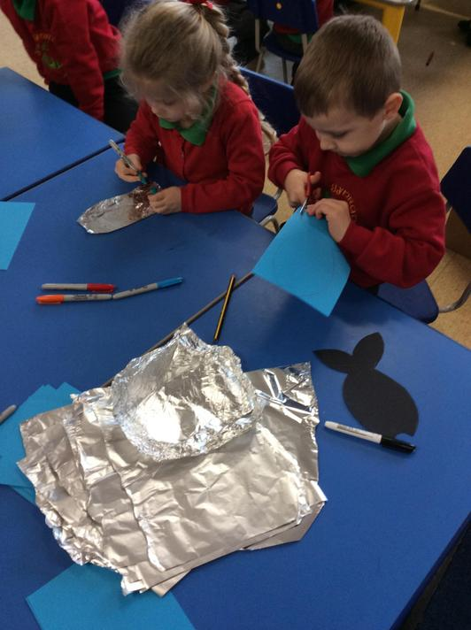 We made our own rainbow fish using templates and foil!