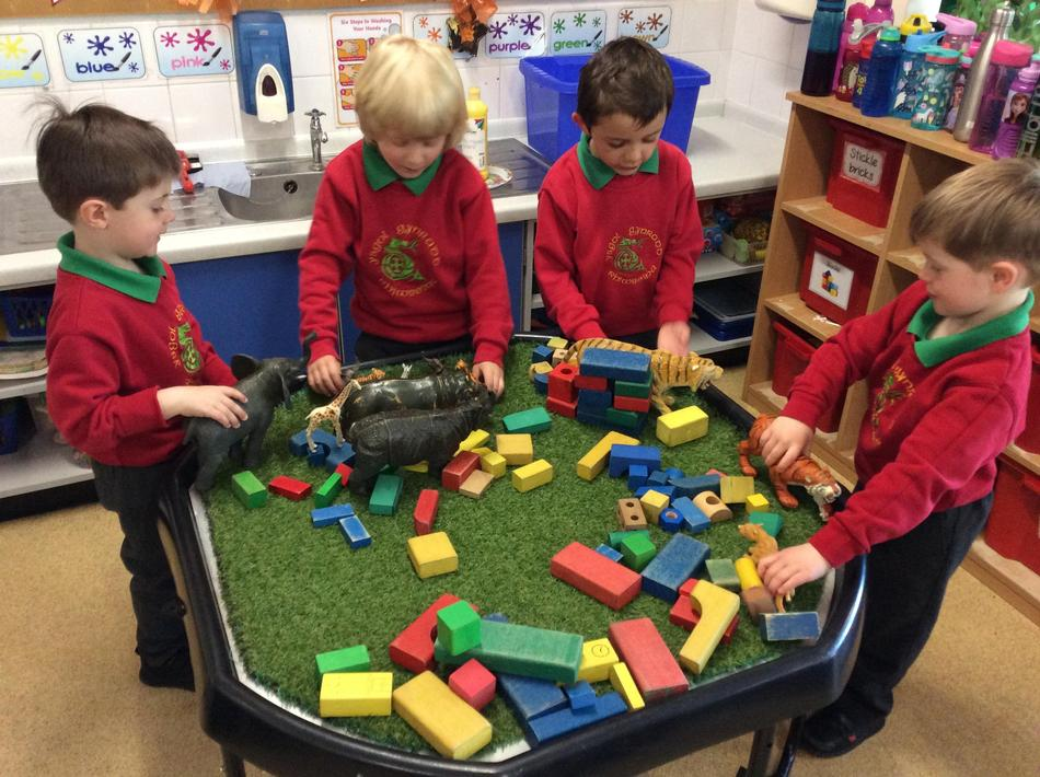 We made dens for our jungle animals that were out in the grass without shelter!