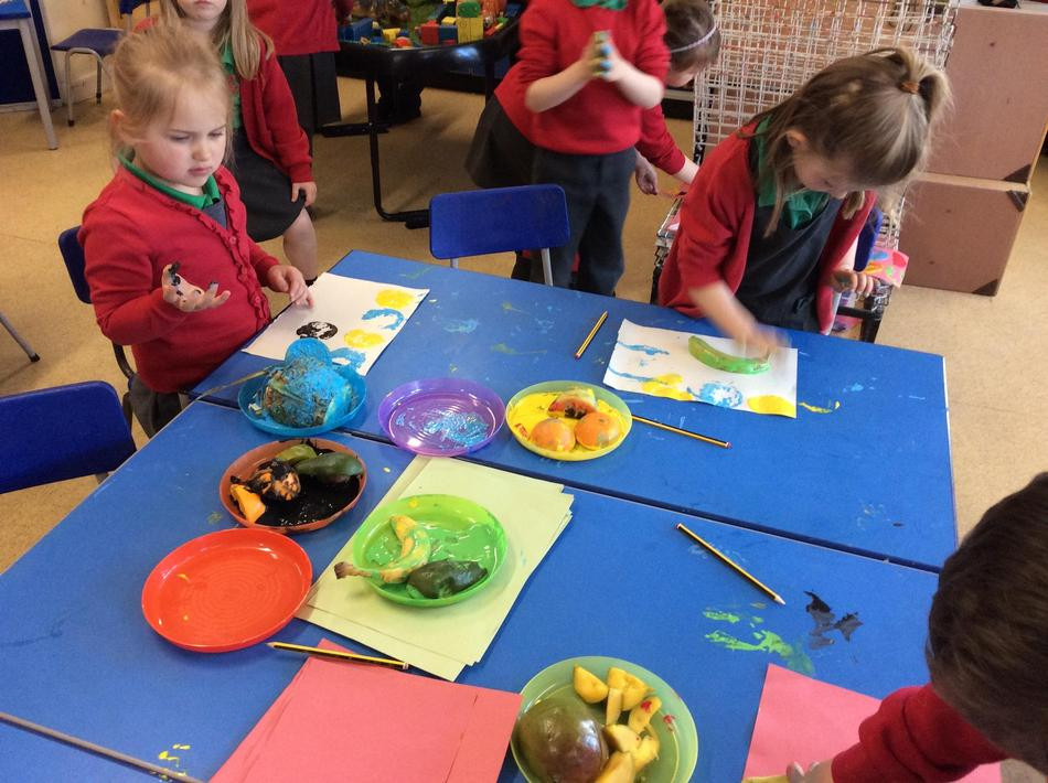 We cut up the fruits in different ways and printed away.