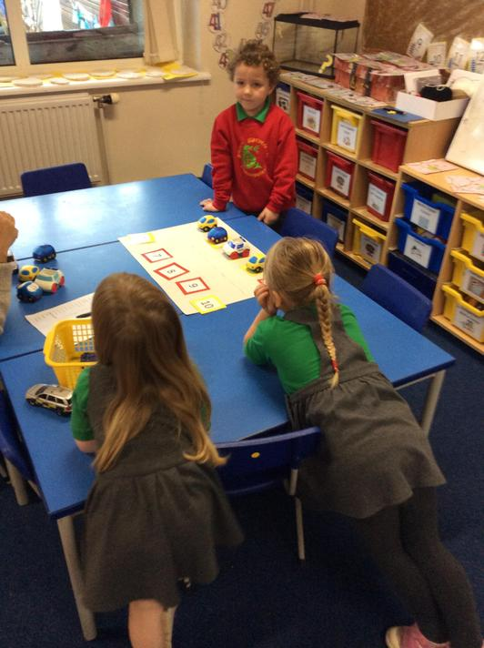 We made our own car park and found one more and one less with a teacher too!