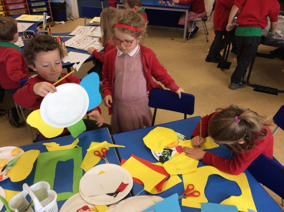 We stamped square patterns on paper plates to make Elmer role play masks.