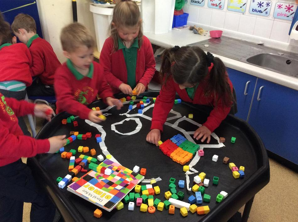 We made our own patchwork Elmer in the tuff spot using blocks.