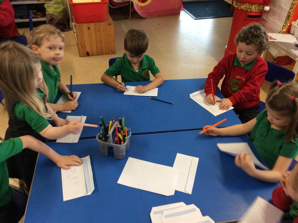 We have written our letters to Santa and have been busy designing our envelopes.
