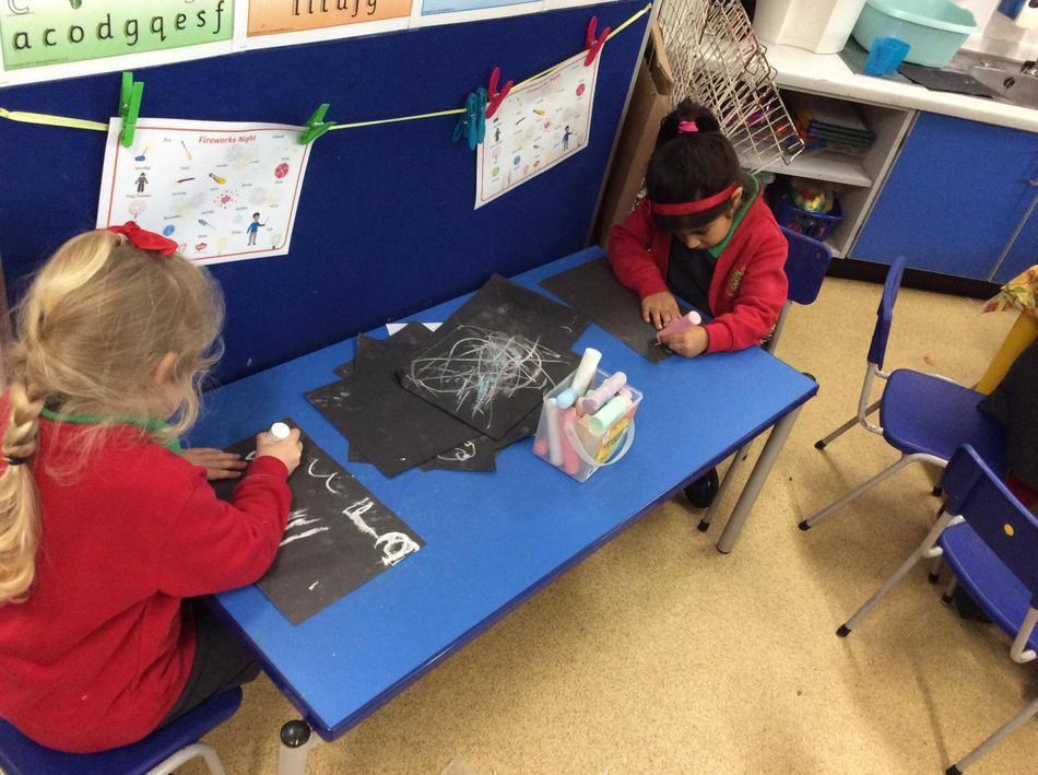 We made firework words with chalks.