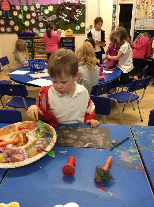 We made our own colourful Rangoli patterns to display