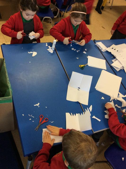 Then we showed Arthur how to use scissors by making snowflakes!
