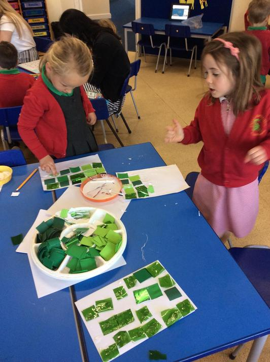 We collaged using jungle colours and animal pictures. Sticky!
