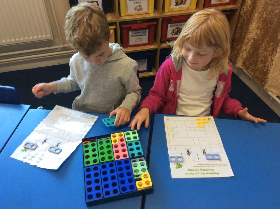 Making castles using Numicon, exploring how the pieces can fit together.