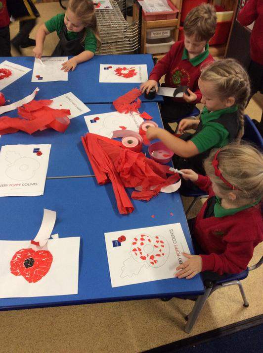 On Remembrance Day we collaged poppies!