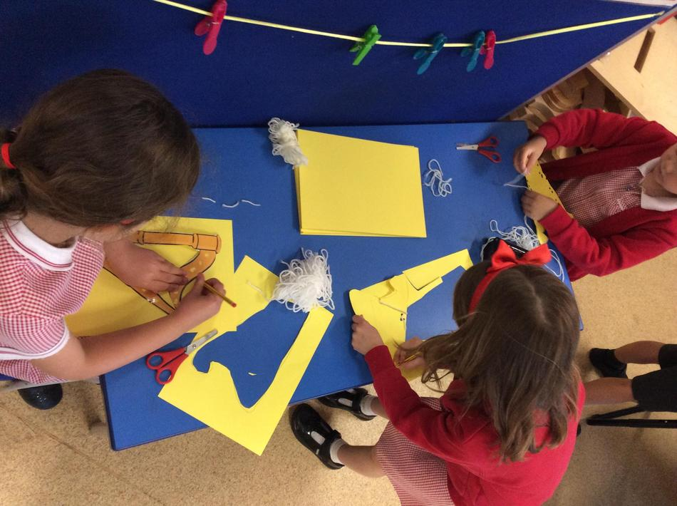 Making our own harps using our fine motor skills!