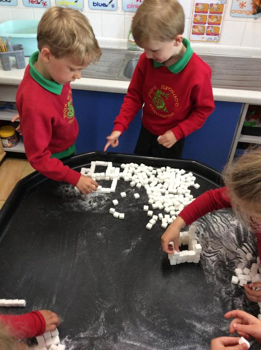 Working as a team to build castles out of sugar cubes!