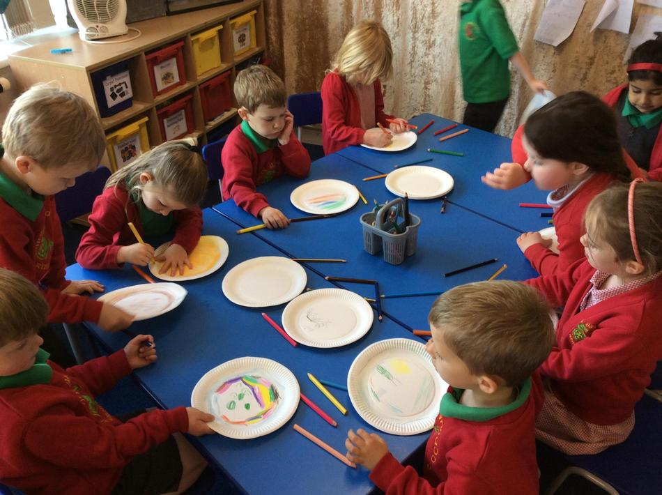 Designing our party plates for our tea party.