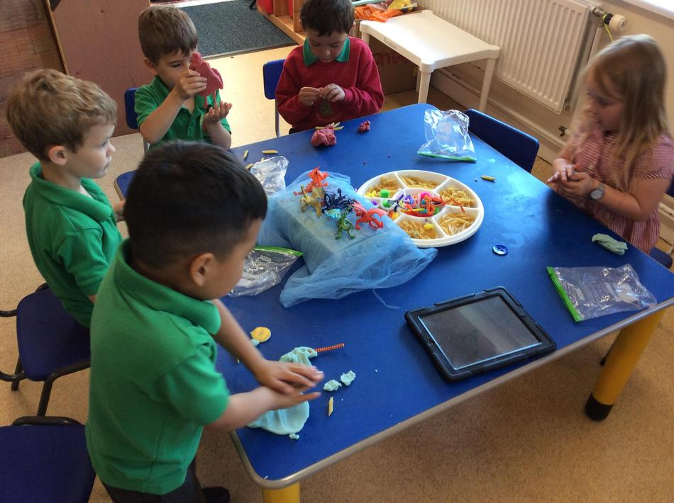 We made playdough dragons using objects to create features.