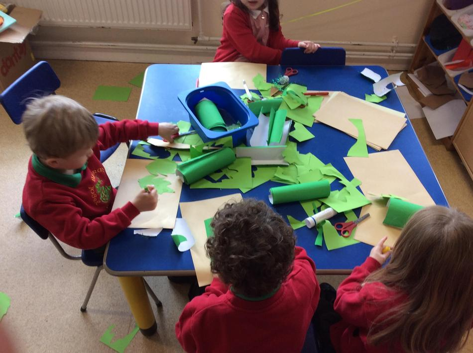 Making a jungle to put our shaving foam tigers in.