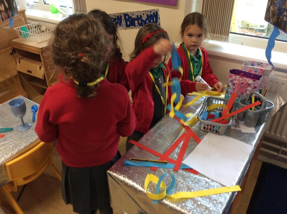 In our role play corner we made paper chains independently