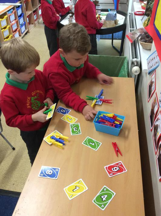 Put the right number of pegs on each card.
