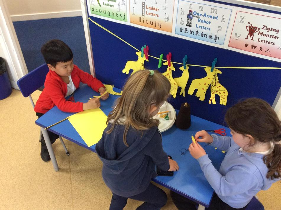Tracing, threading, tying knots and printing...all on one giraffe!