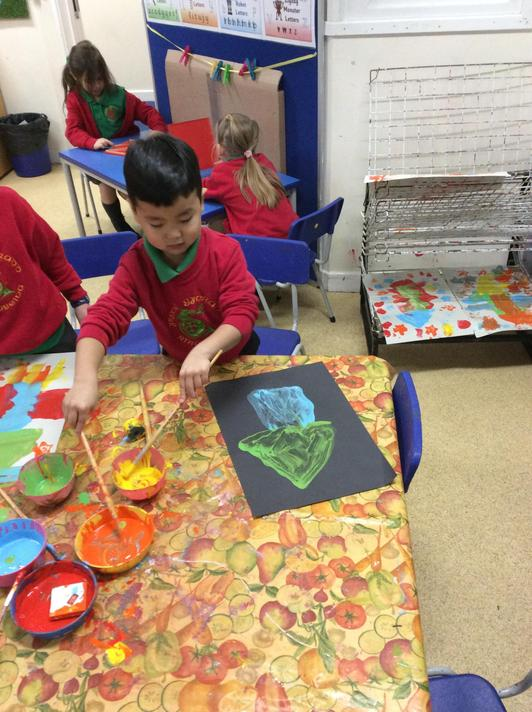 We painted our own rockets thinking about light, dark and 2D shapes!