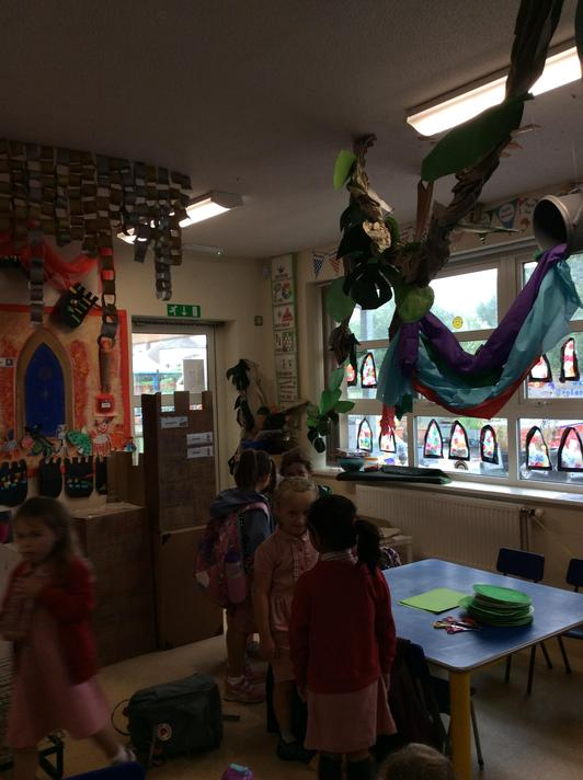 A beanstalk has grown in our classroom! It goes in the ceiling!