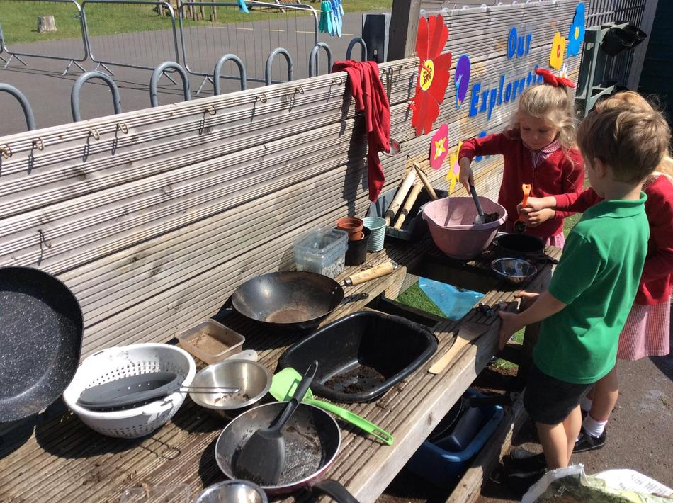 Making food for the giant in the mud kitchen.