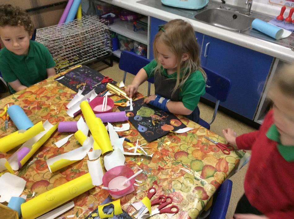 Collaging on top of our paintings for fireworks - it was very effective!