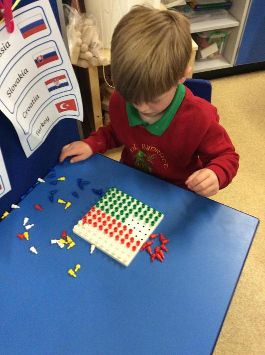 Making our own castle flags using pegs and boards