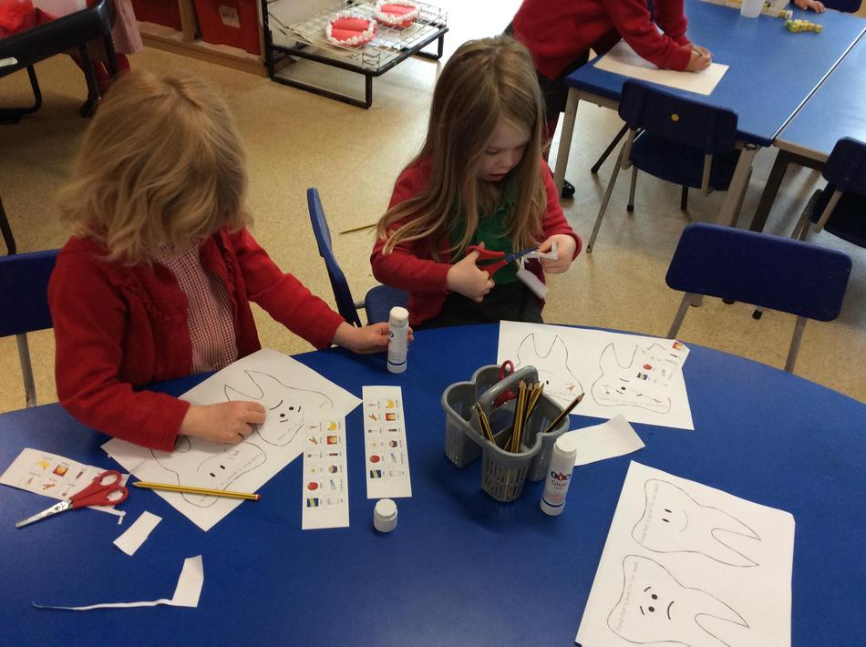 We used our scissor skills to sort healthy and unhealthy foods and drinks for our teeth.
