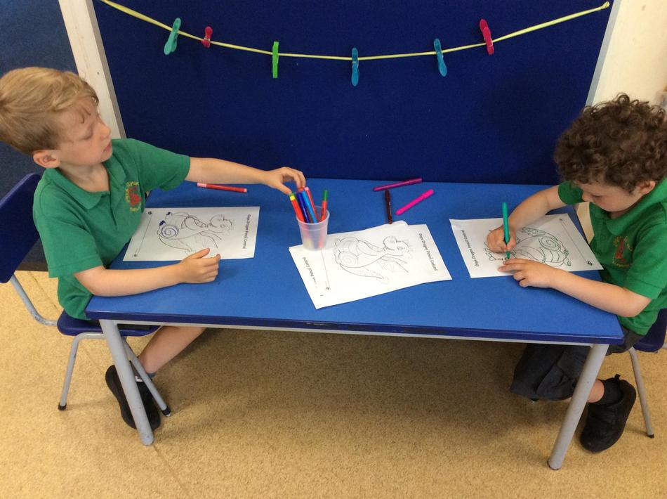 Practising our fine motor skills by carefully tracing over fine lines!