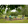 Many children enjoy working in the allotment area.
