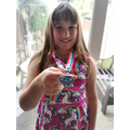Andrea received a Stay at Home medal from the NHS