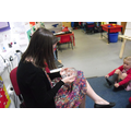 Nursery children and Mrs Campbell held the Moon