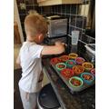 Kai making Rice Krispie cakes