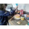 Myla decorating her cake