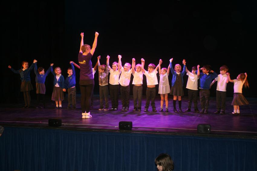 Year one performing Singing in the Rain dance!